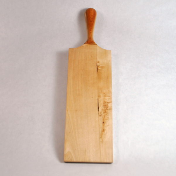 Birch spanking Paddle with yew handle stood up